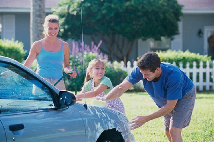 family-washing-car,-adopted-child