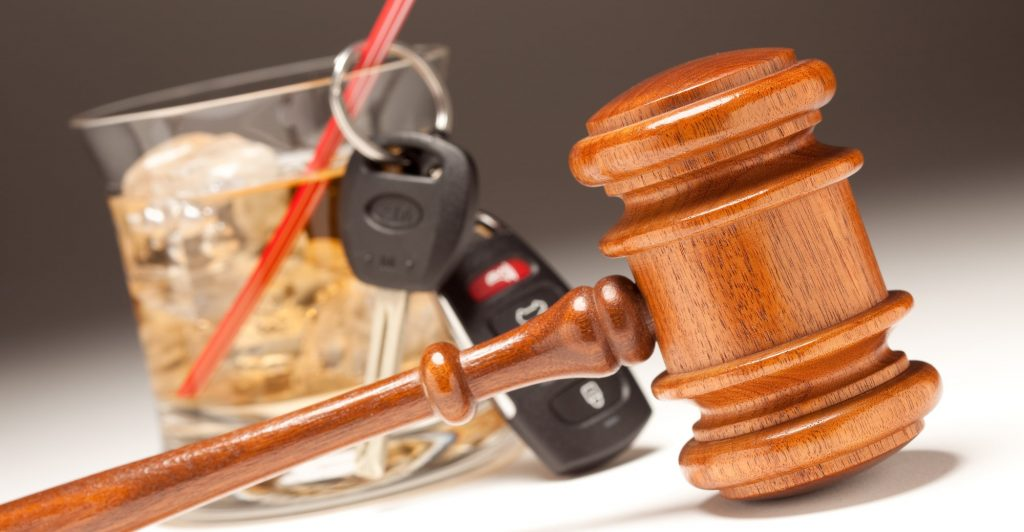 Gavel, Alcoholic Drink and Car Keys on a Gradating to White Background - Drinking and Driving Concept.